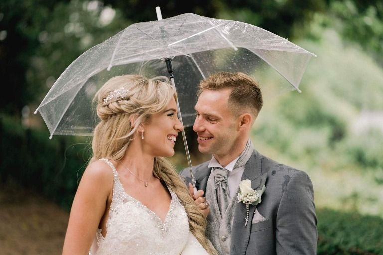 Bride and groom on their wedding day at Richmond Hill Hotel in Surrey