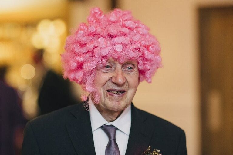 Pink wig on a wedding guest.
