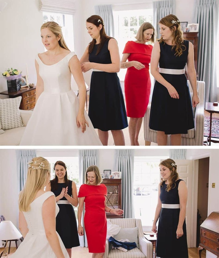 Tying the back of the wedding dress.