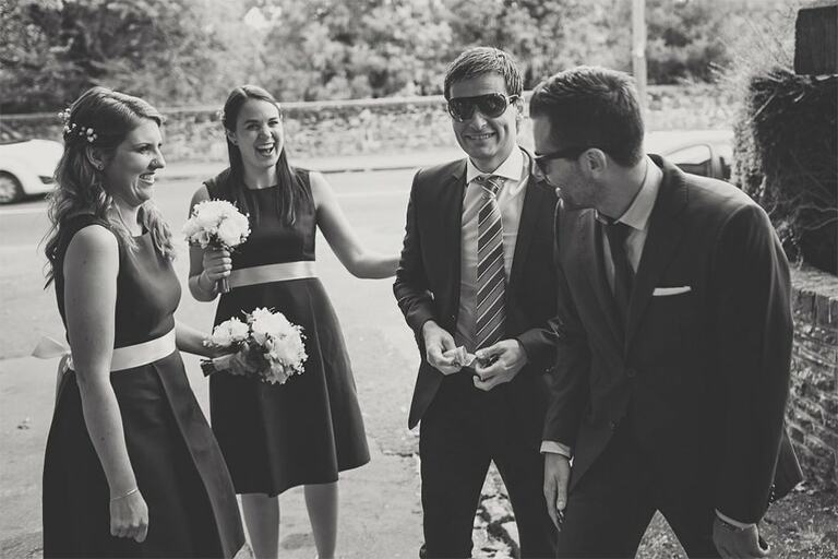 Guests laughing at a wedding.