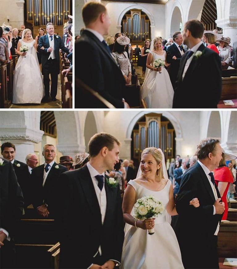Bride walks down the aisle and see her husband to be in a church.