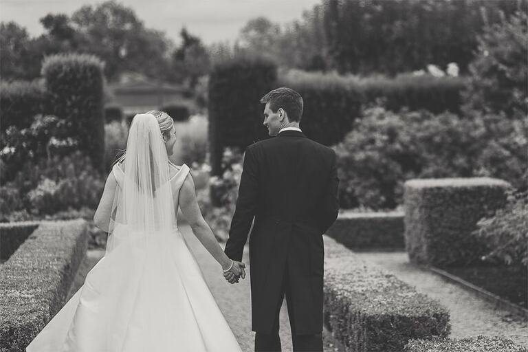A couple walking together on their wedding day.
