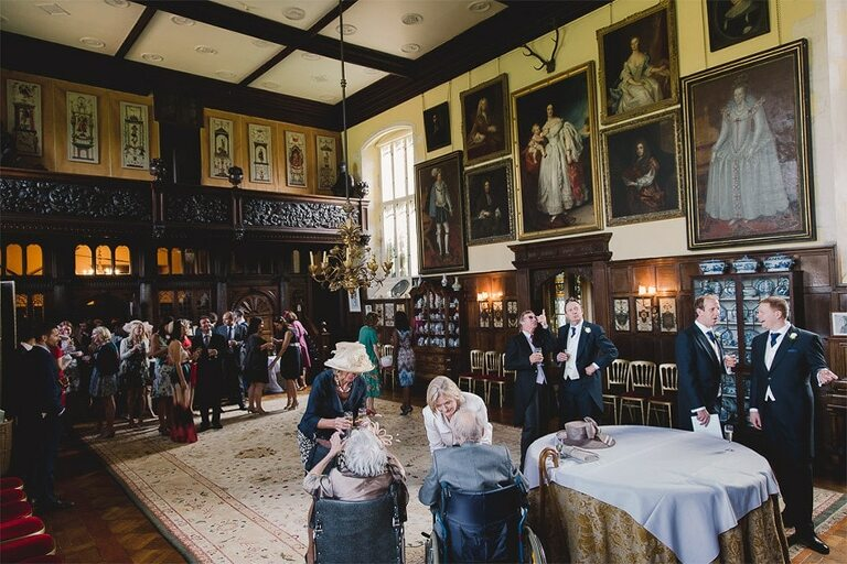 Loseley park wedding reception with a room full of guests.