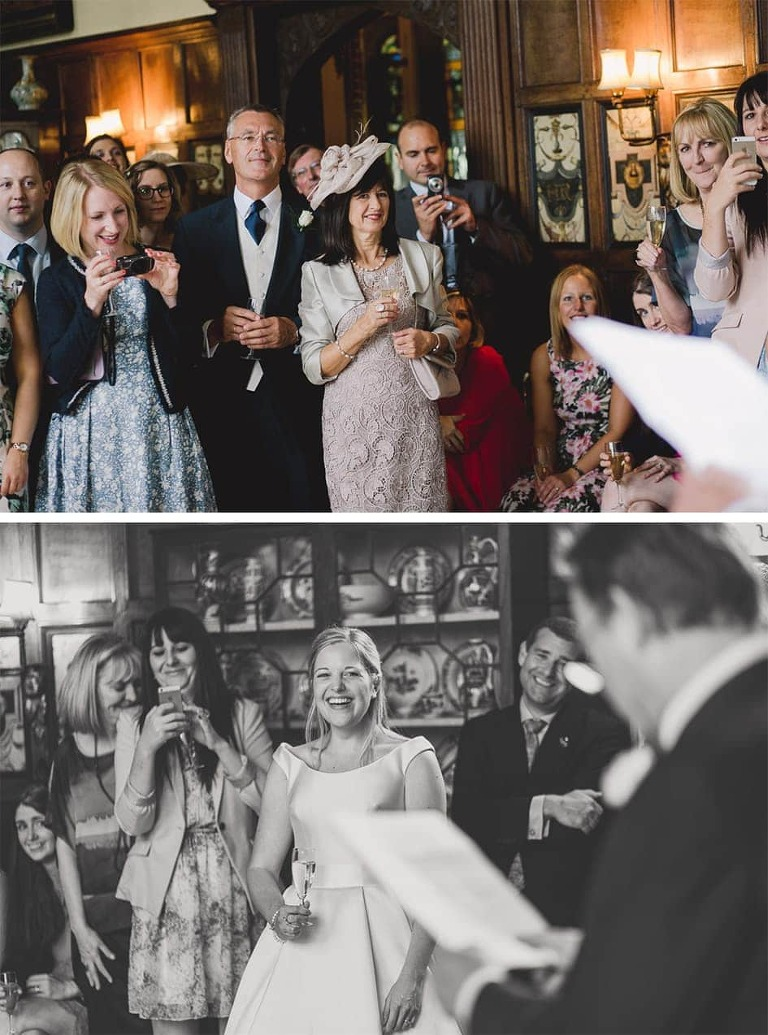 Guests listening to speeches at Loseley wedding.