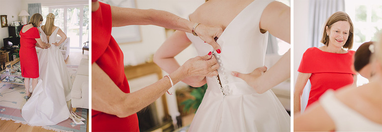 Bride putting on the dress.