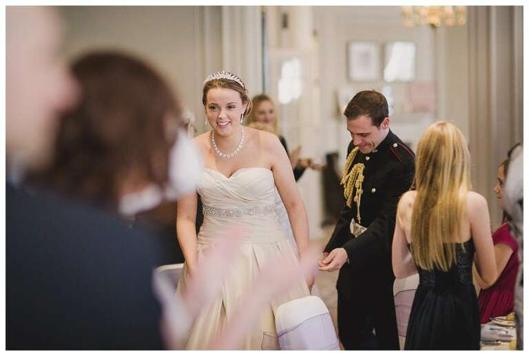 Gorse ~Hill bride and groom walk in the room.