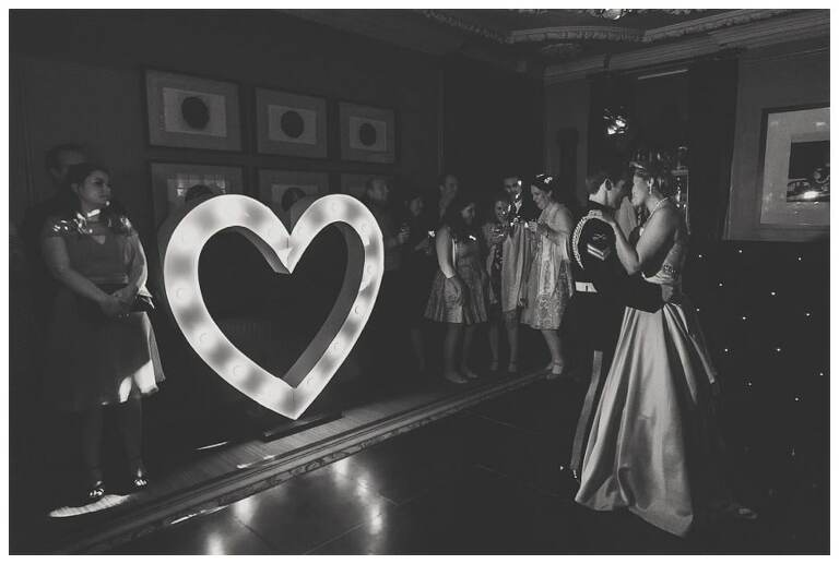 First dance with love sign.