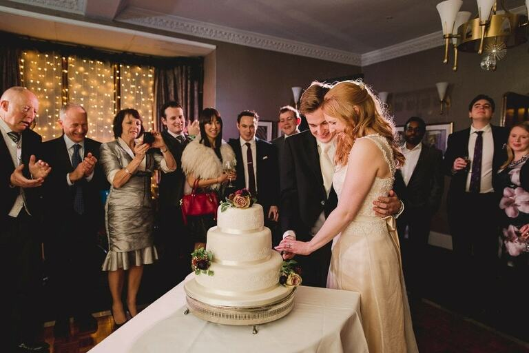 Cutting the cake at Nutfield Priory wedding.