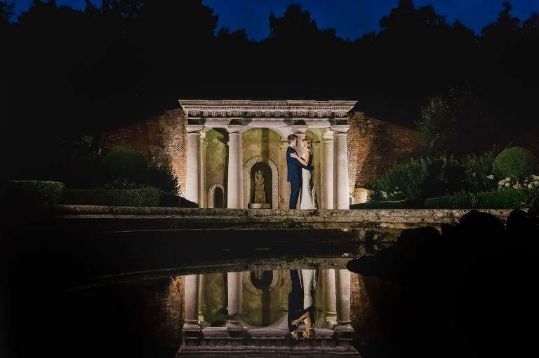 A refection of the bride and groom during their wedding in Surrey.