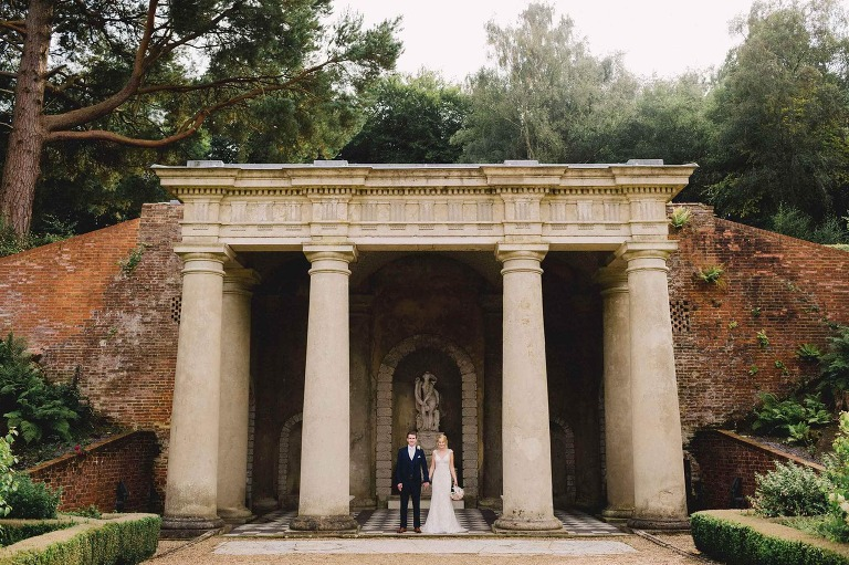 Wotton House temple with the bride and groom.