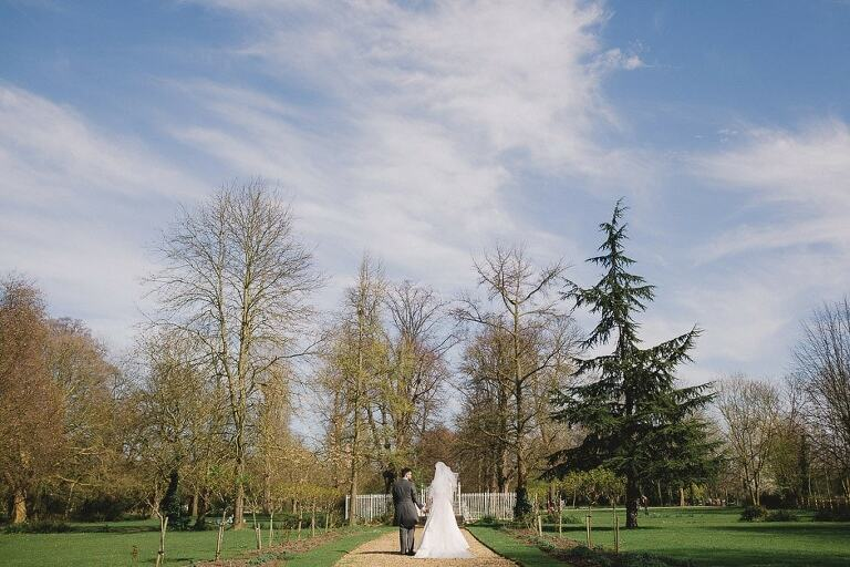A married couple take a walk at Morden Hall in Surrey.