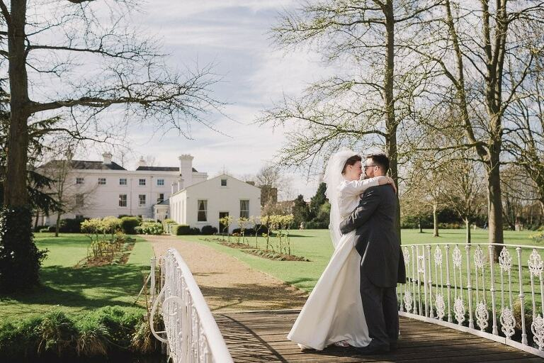A couple hug on the bridge at Morden Hall in Surrey.