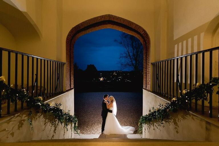A couple enjoying the night sky at Farnham castle on their wedding day.