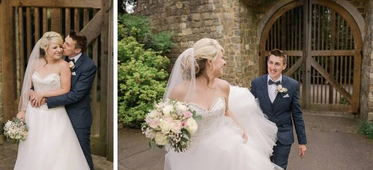 A couple smiling on their wedding day at Farnham Castle.