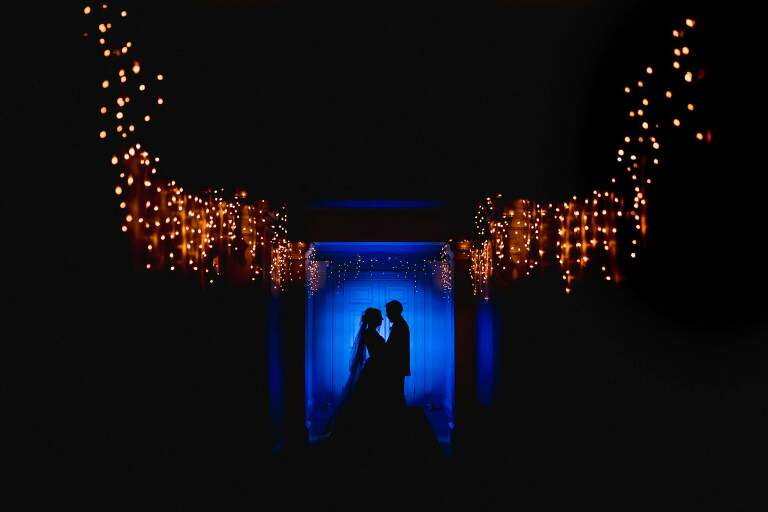 Silhouetted Bride and Groom at Buxted Park Wedding Venue in Sussex