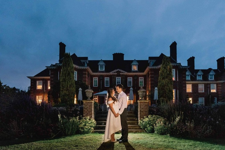 Bride and groom on their wedding day at Barnett Hill in Surrey