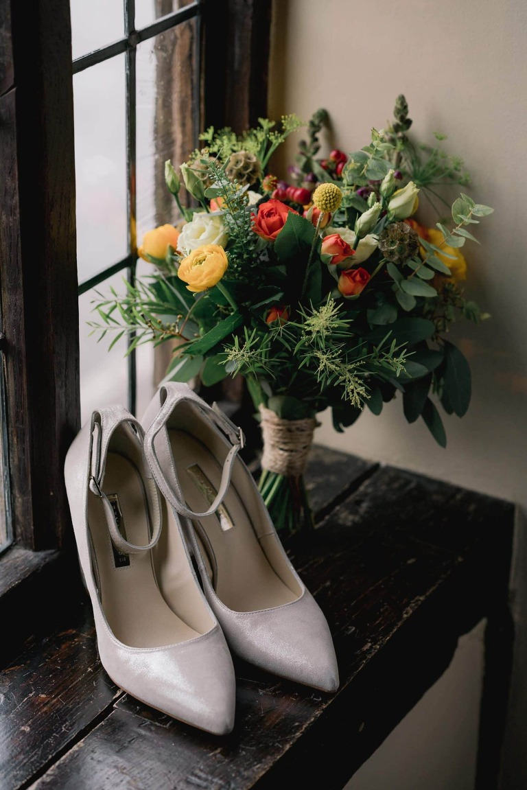 Wedding shoes and flowers at Ramster Hall.