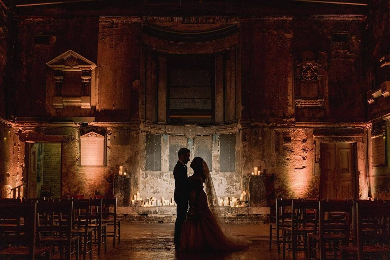Asylum Chapel Wedding Photographer in London creating silhouettes of the bride and groom.