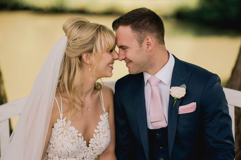 Bride and groom cuddling at Lythe Hill Hotel in Surrey.