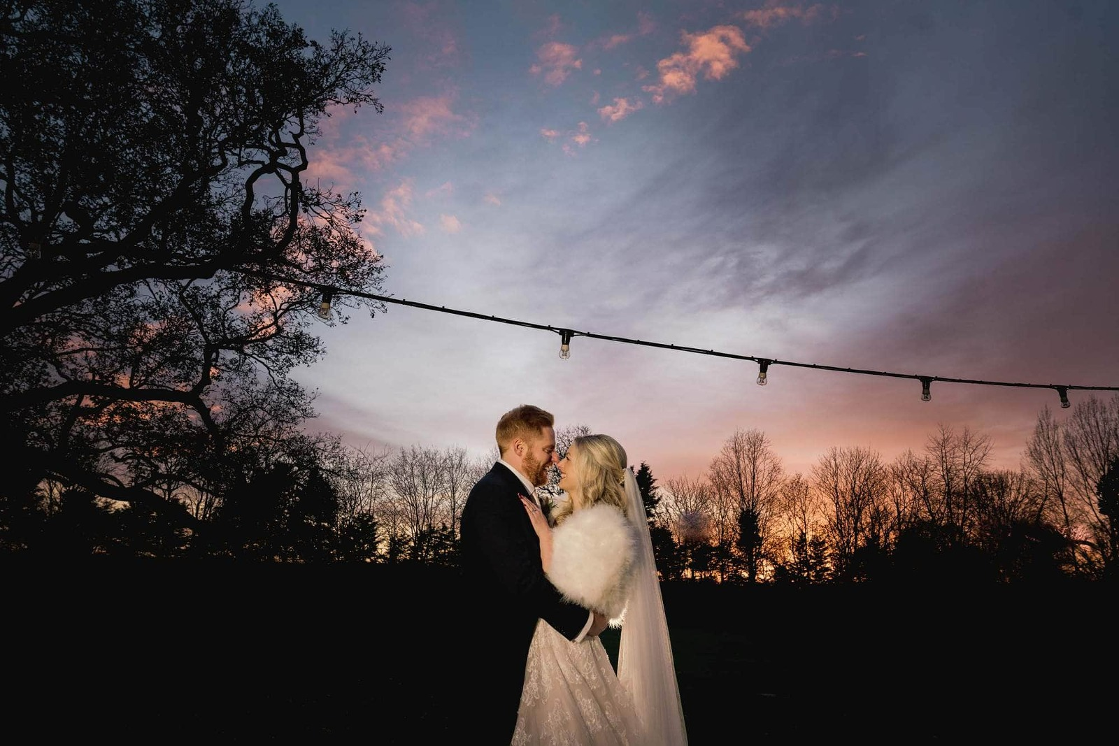 Kent Wedding Photographer at Sunset with bride and groom.